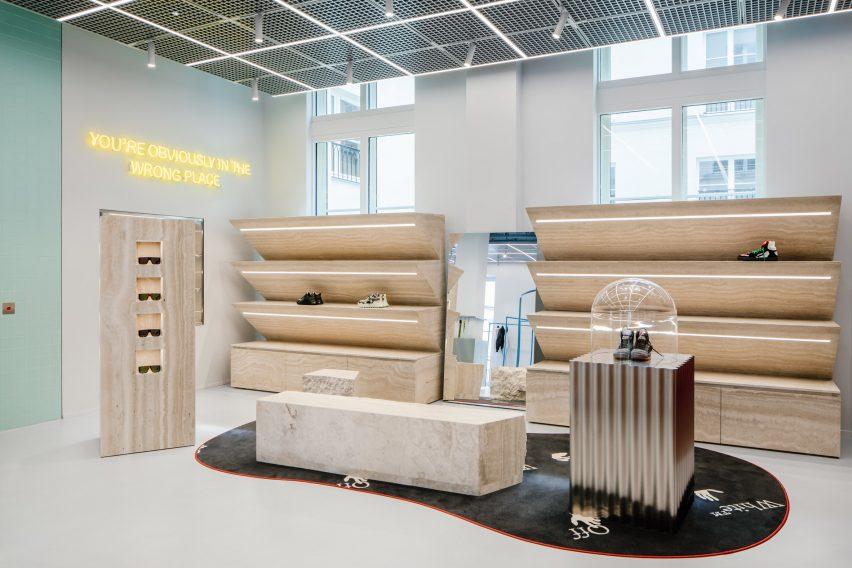 Travertine displays in retail interior by AMO