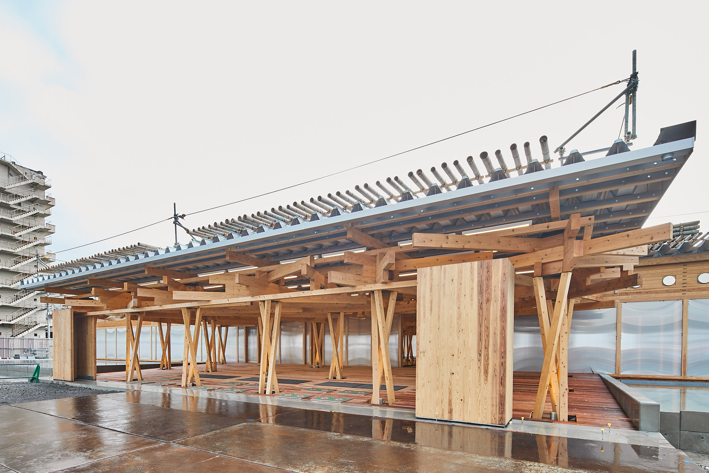 Beams were stacked at the olympic village plaza