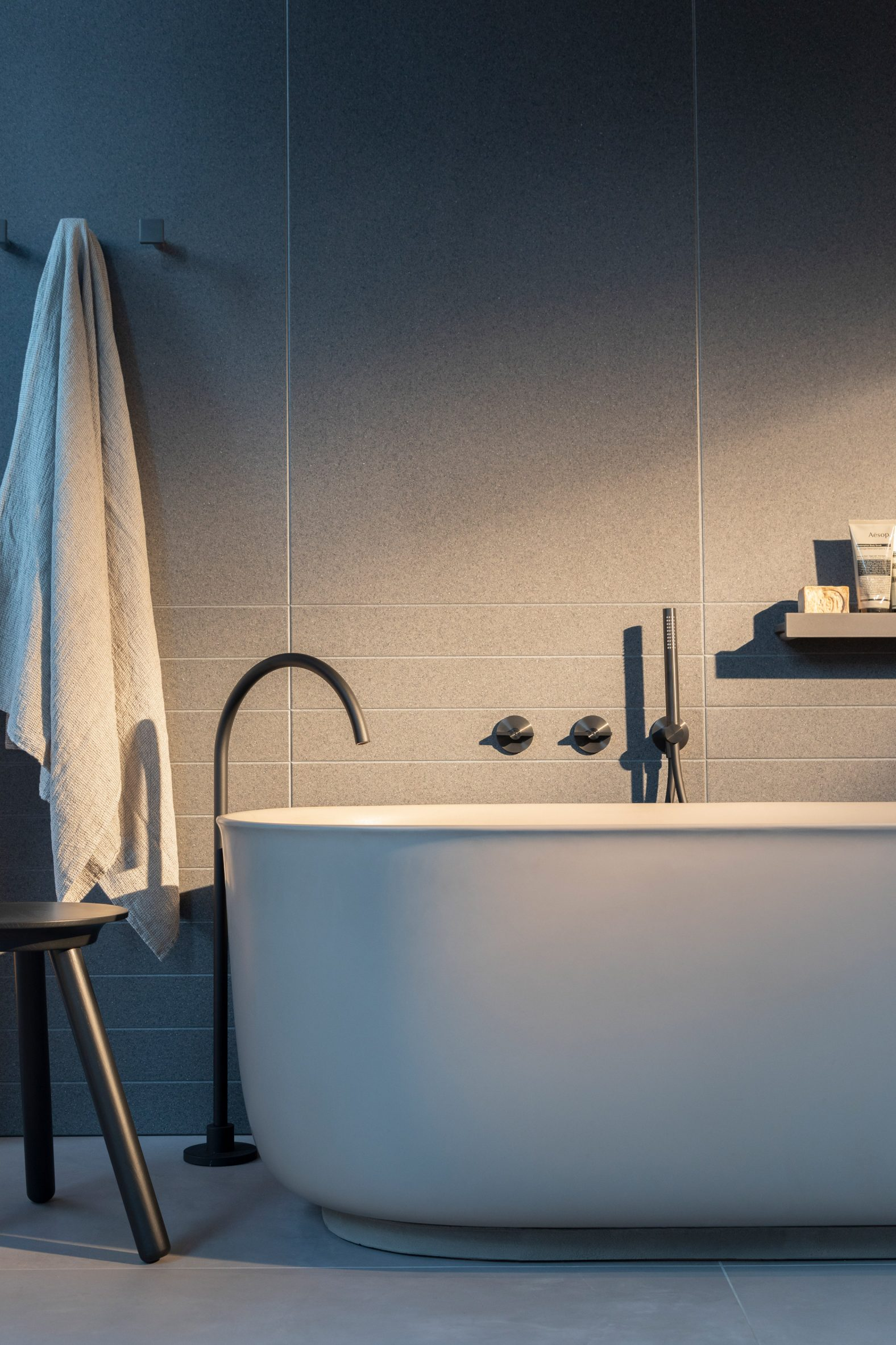 A bathroom with a bath and tap from the Q collection