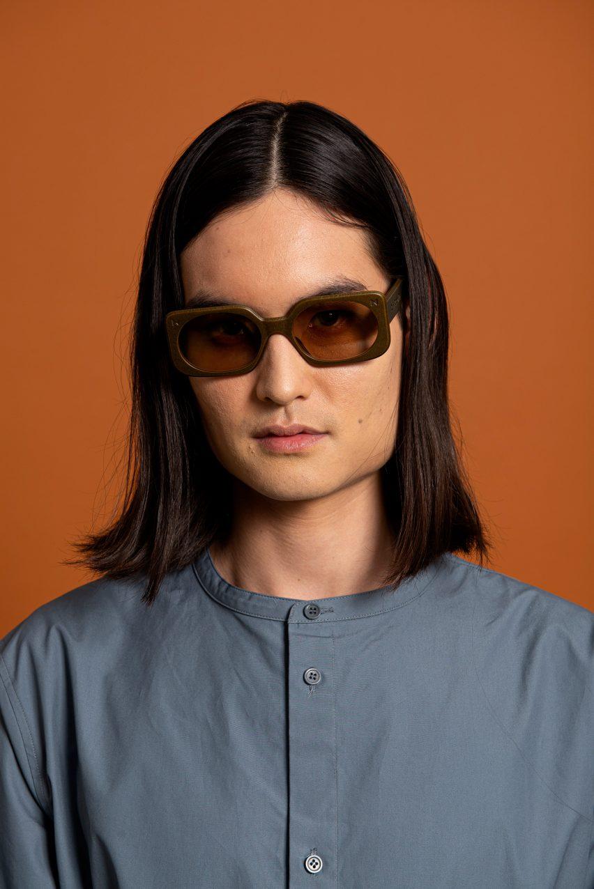 A man wearing rectangular-shaped brown sunglasses