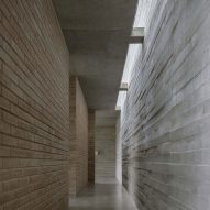 Skylights allow light to floor into the concrete interior