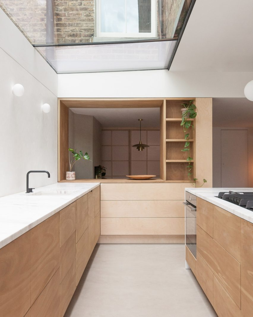 A kitchen with wooden cabinetry