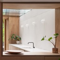 A view into a white-walled kitchen