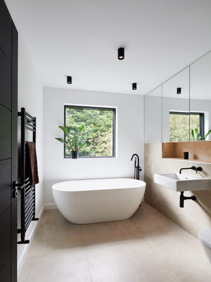 A white bathroom with a freestanding tub