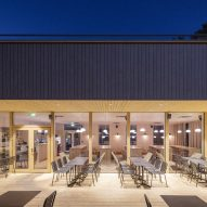 A restaurant with a wooden terrace