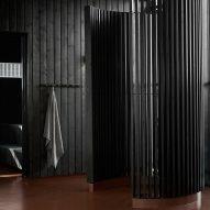 A black timber sauna
