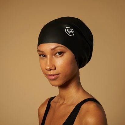 A woman wearing a black soul cap