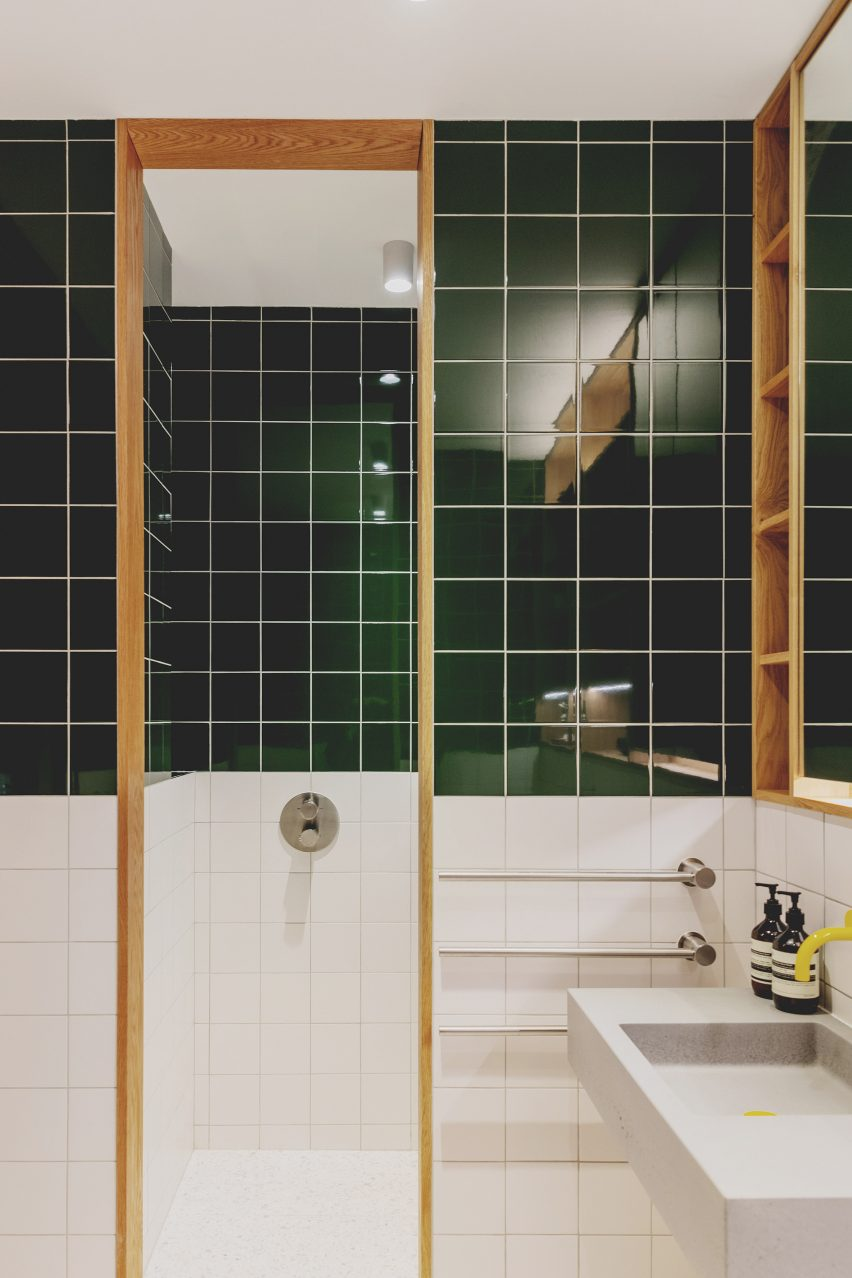 Bathroom with green and white tiling in St John Street Warehouse Apartment by Emil Eve Architects