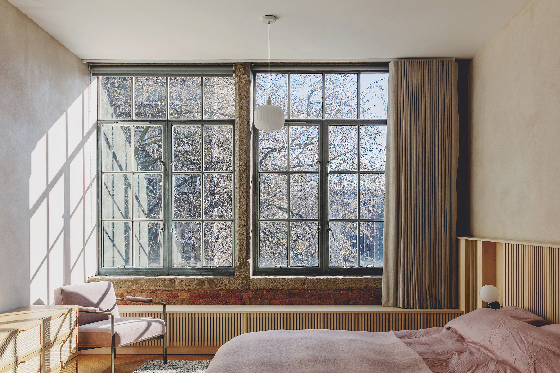 Main bedroom in St John Street warehouse apartment by Emil Eve Architects