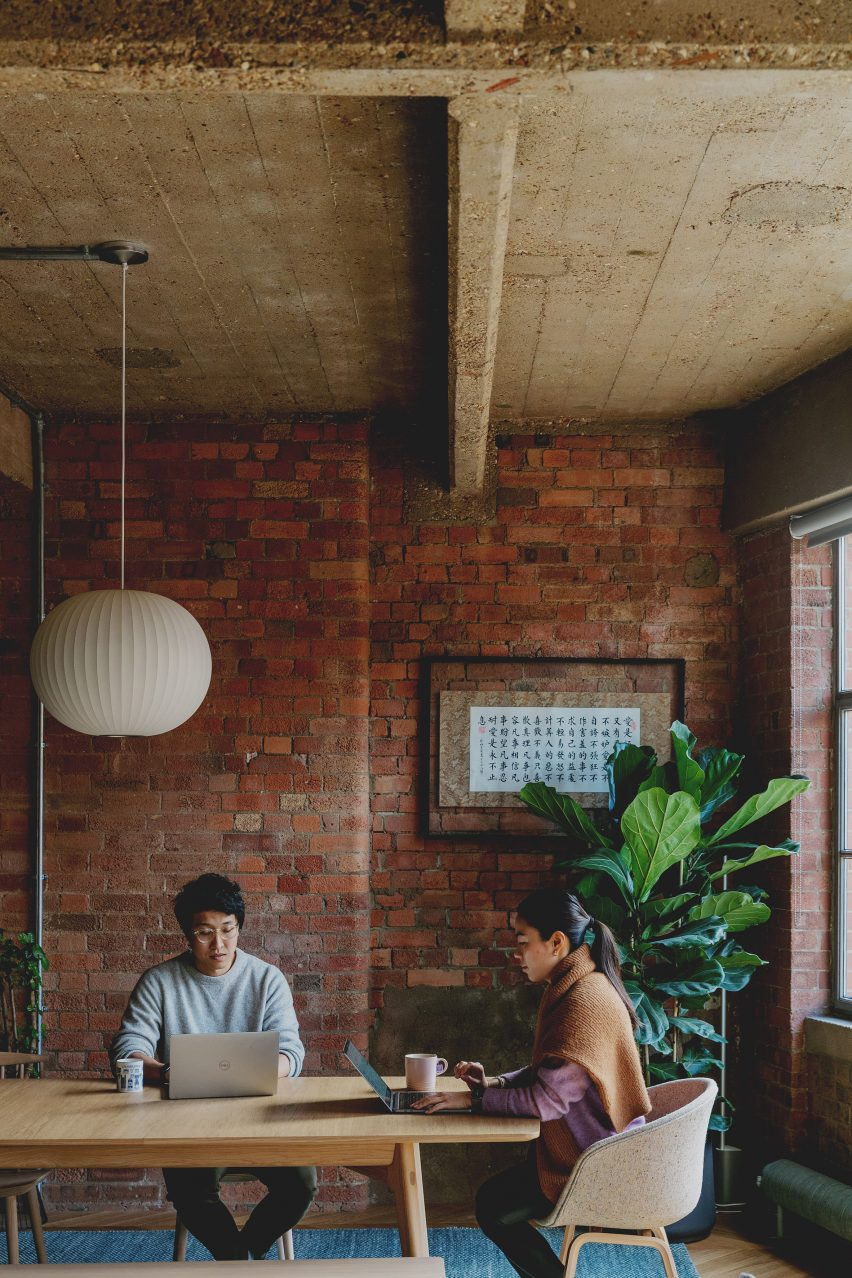 Mike and Jen at the Dining Table in the St John Street Warehouse Apartment by Emil Eve Architects