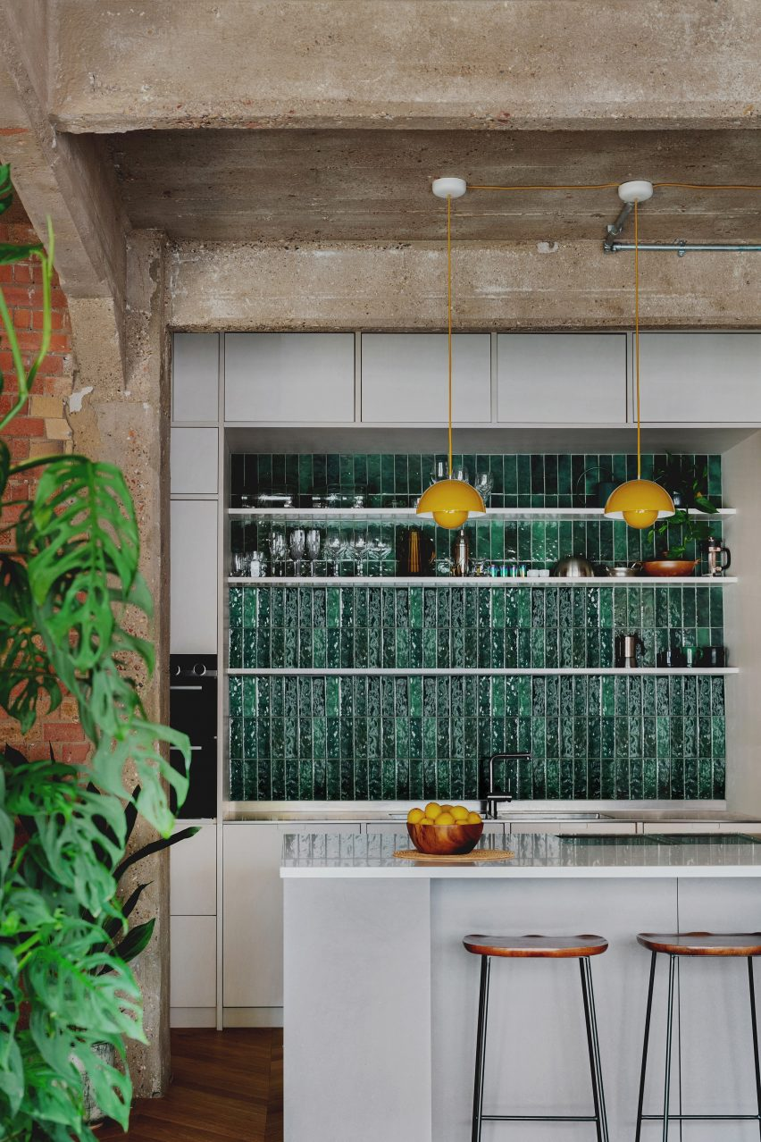 Kitchen with green tiled floors and birch plywood cabinetry in St John Street Warehouse Apartment by Emil Eve Architects