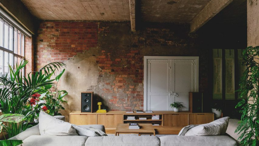 Lounge with custom sideboard in St John Street warehouse apartment by Emil Eve Architects
