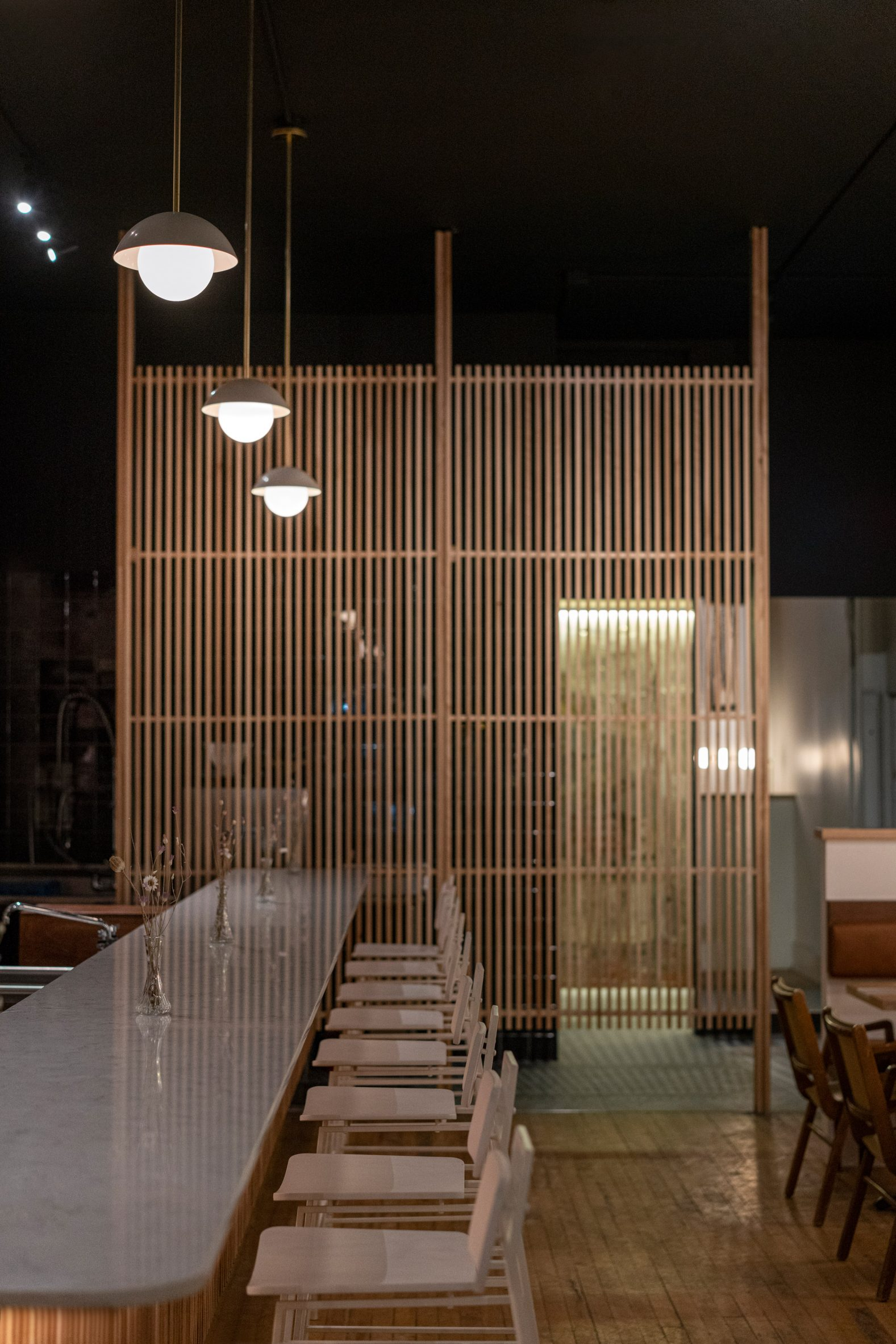 Wine bar in Montreal with a slatted privacy screen