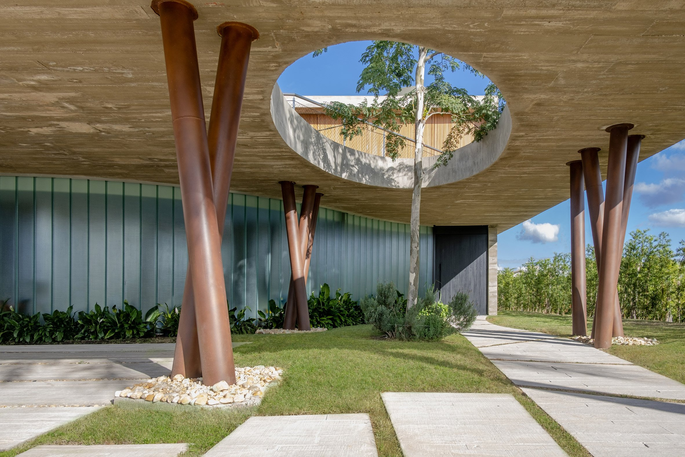 Anada House has a curved walkway supported by columns