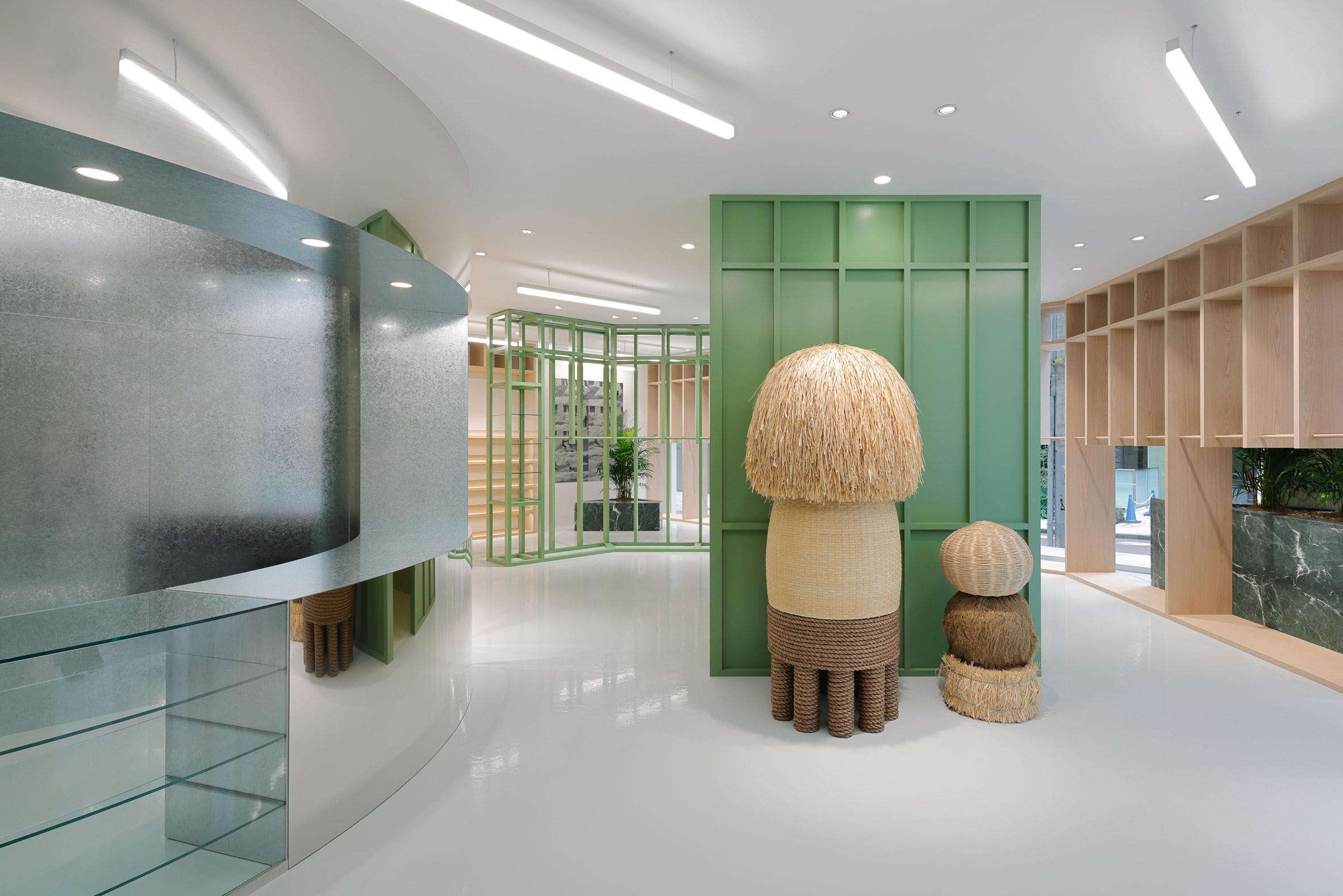 Mirrored counter, mushroom statues and green shelving in Stüssy Shibuya store