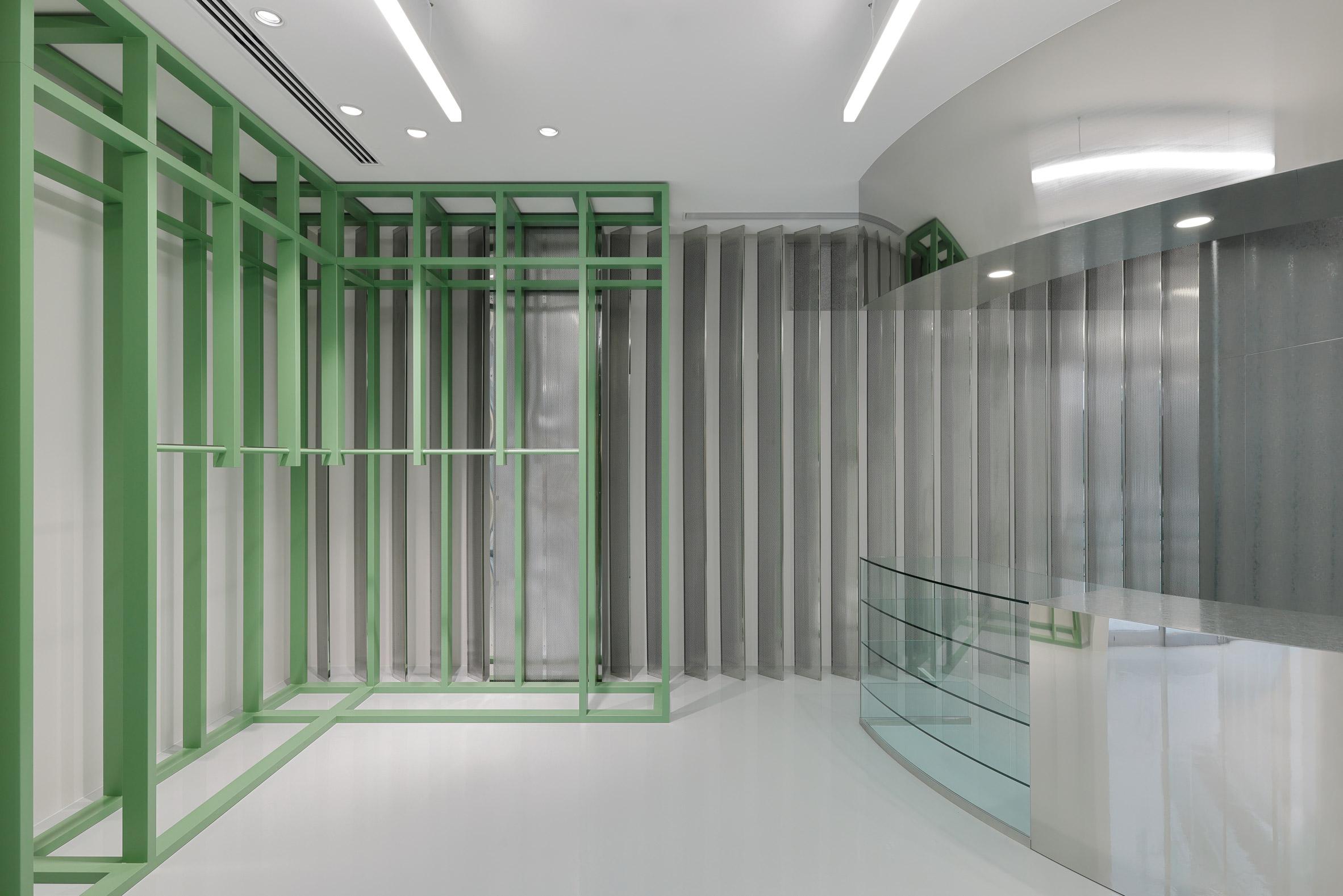 Green shelving and mirrored storage in Stüssy Shibuya store