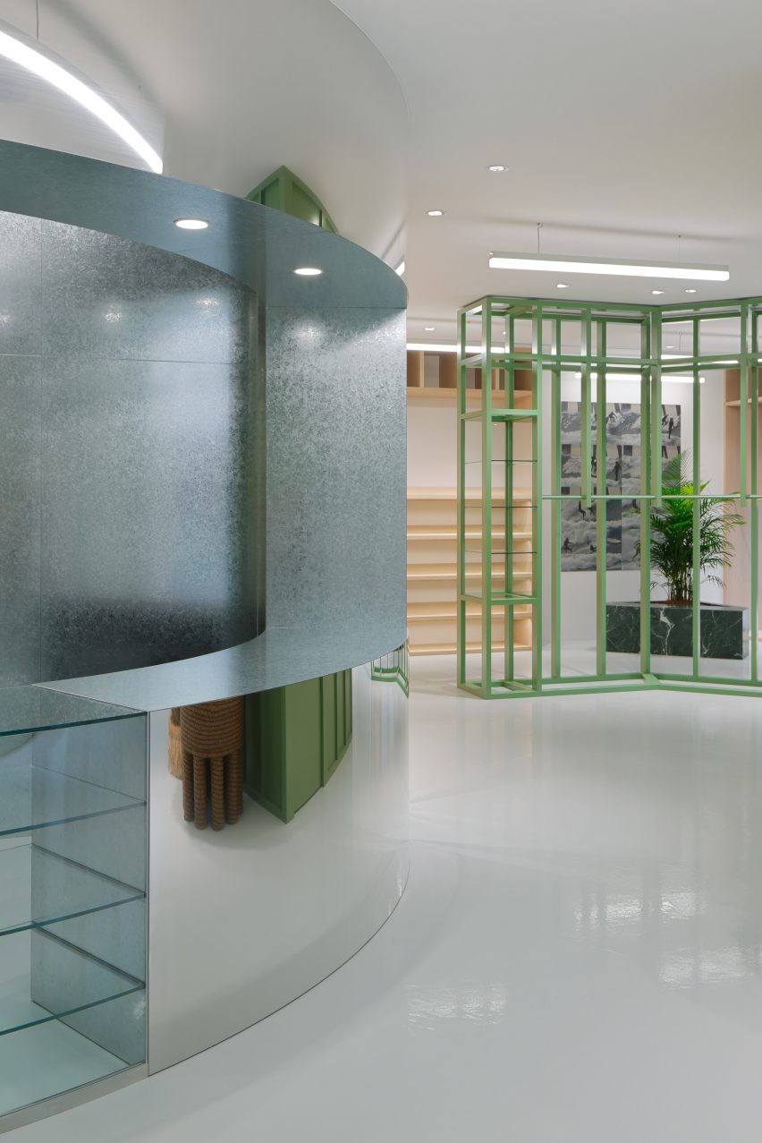 Green shelving and mirrored counter in Stüssy Shibuya store