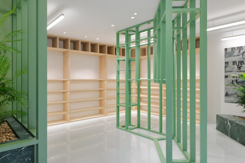 Green and wooden shelving in retail interior by Perron-Roettinger