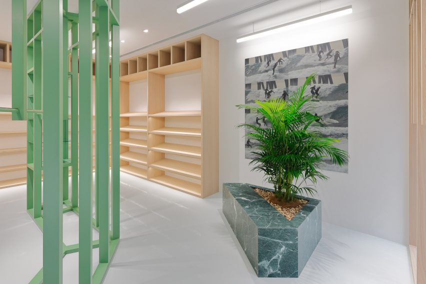 Green and wood shelving with green marble planter in Stüssy Shibuya store
