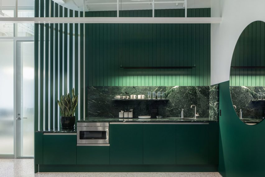 Green kitchen of office interior in Chicago by HHF and Kwong Von Glinow