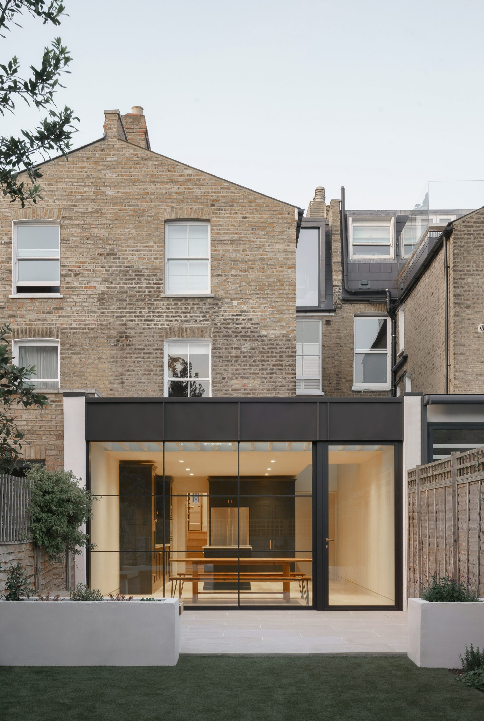 Rear facade and garden of T-House by Will Gamble Architects