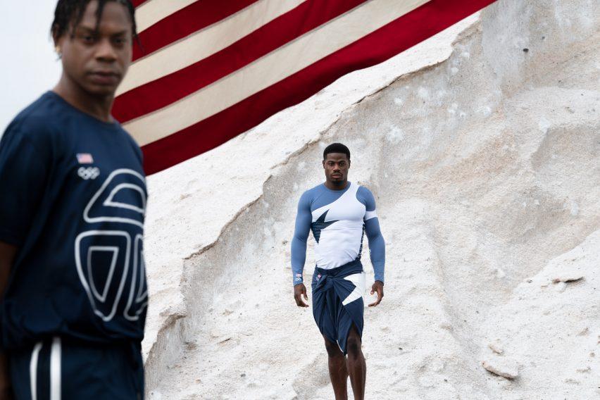 Two men wearing blue and white telfar olympics uniforms