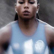 A woman wearing Telfar's Olympic uniform