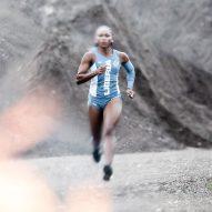 A female sprints in Telfar's Olympic uniform