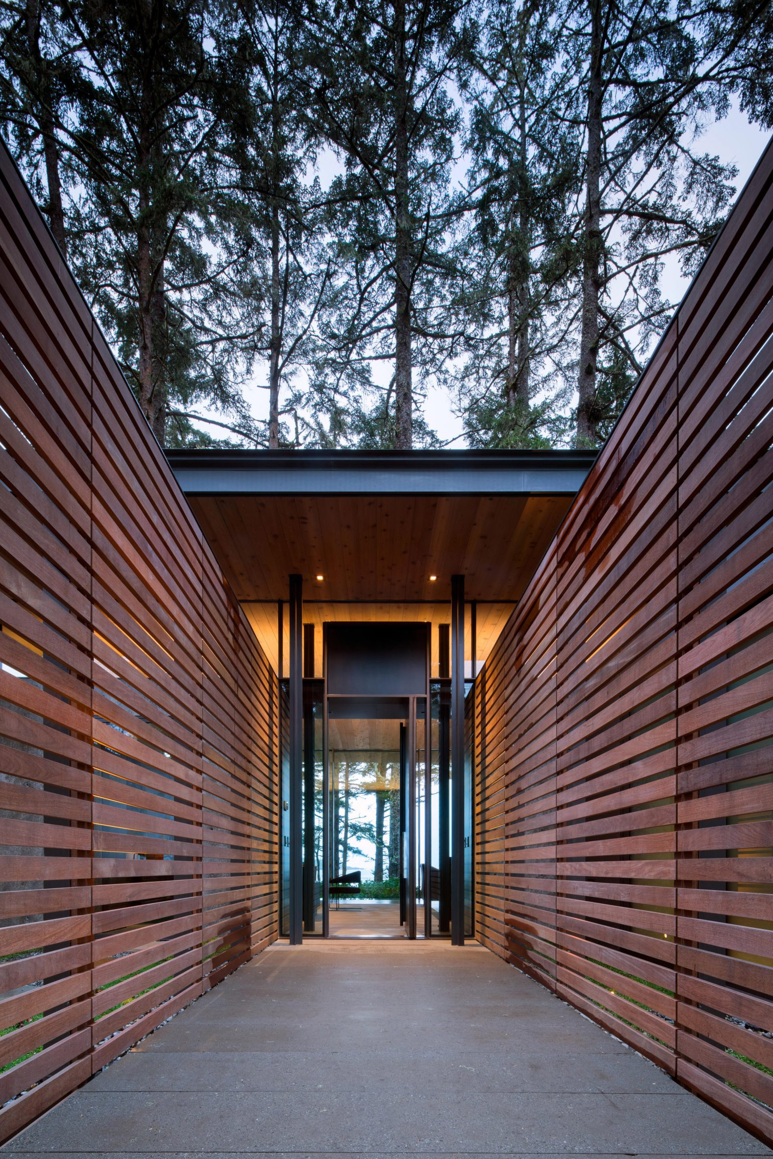 Wooden slats entrance to beach home Tofino Olson Kundig