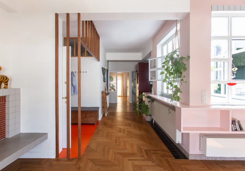 Wooden floors and pink shelves in the Trikoupi apartment