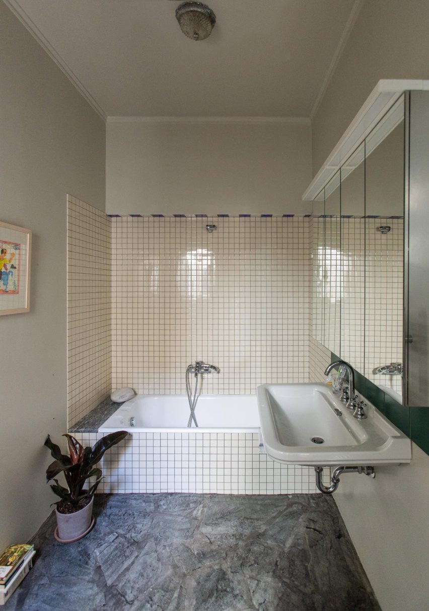 Bathroom with white tiles and marble floors in Trikoupi apartment