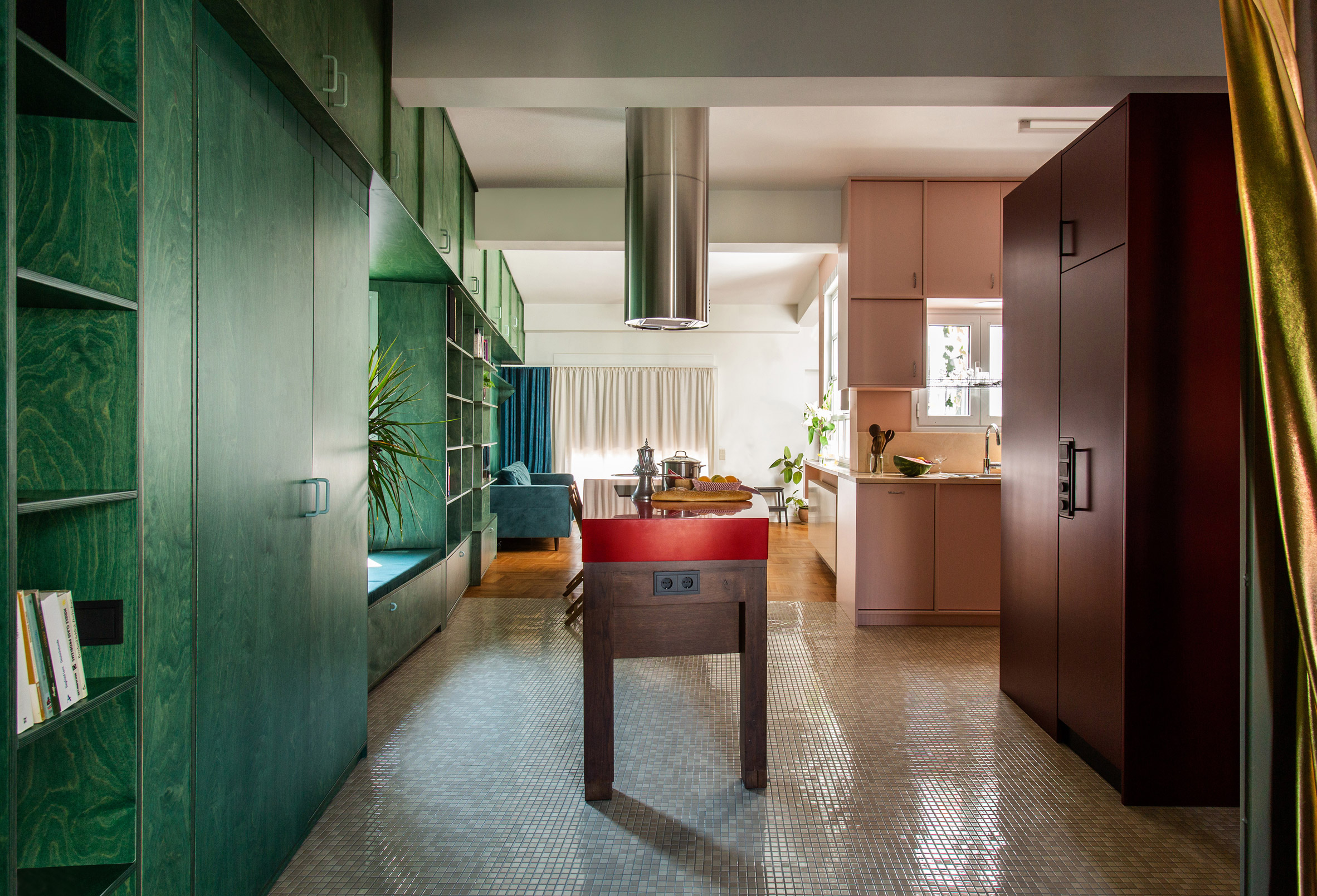 Kitchen with wooden island and built-in green shelves in Trikoupi apartment