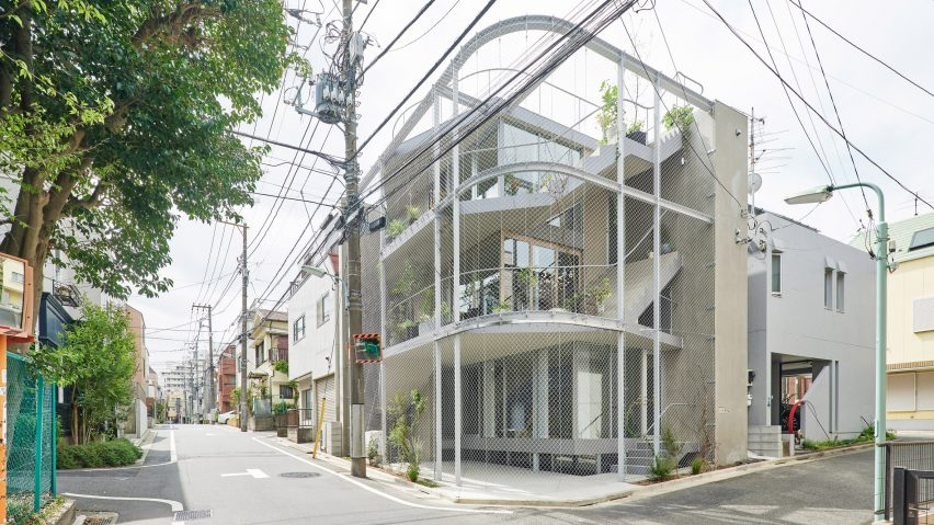 A Japanese house covered in metal mesh