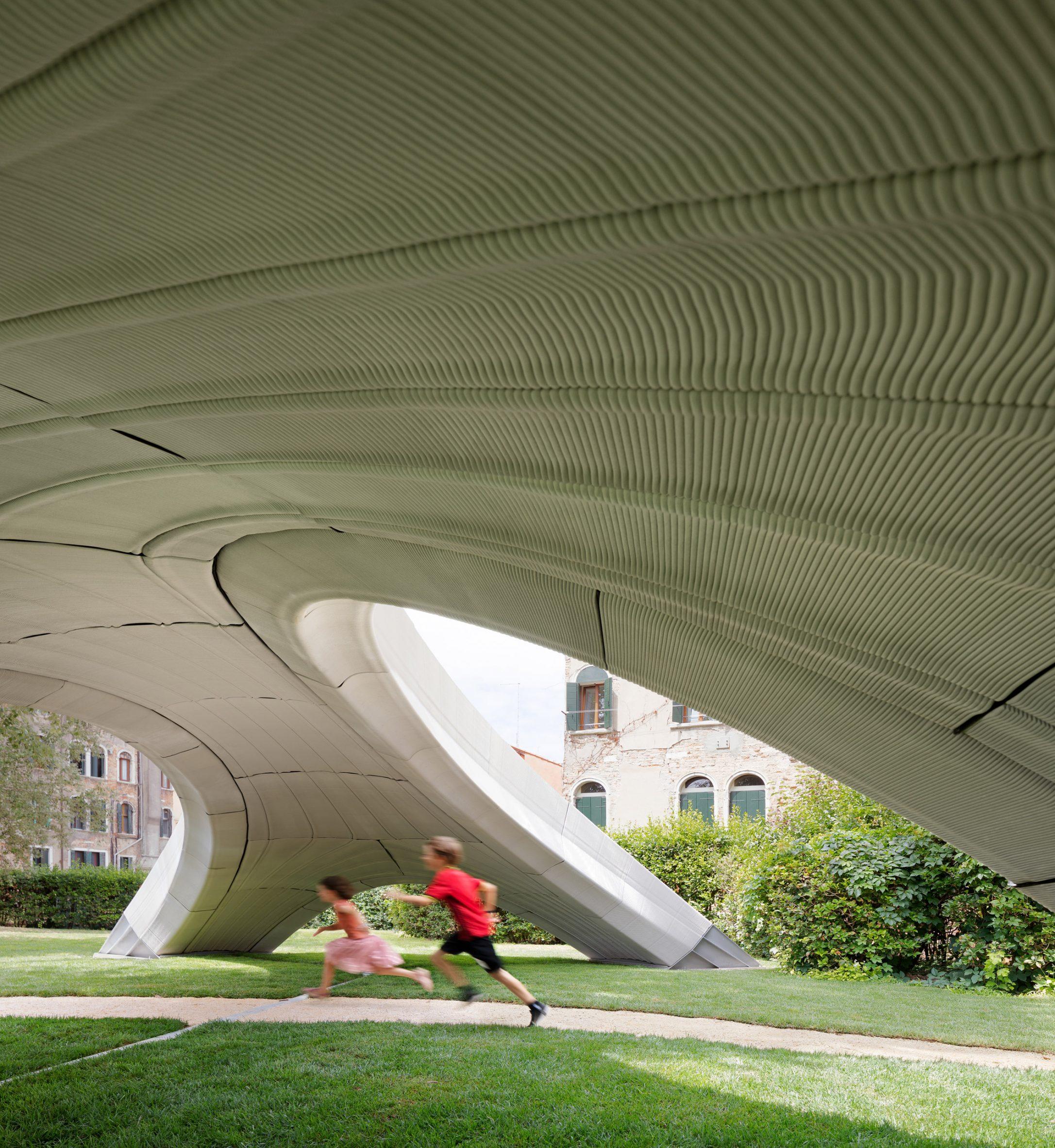 Children pictured running under the bridge