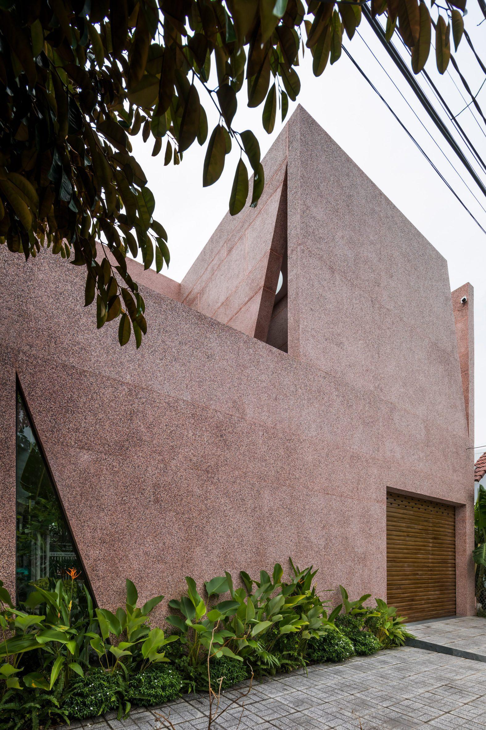 Pink house has a pebble dash exterior