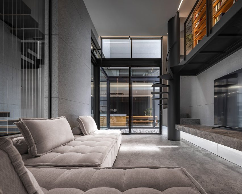 Living room with mezzanine study, 55 Sathorn house by Kuanchanok Pakavaleetorn Architects