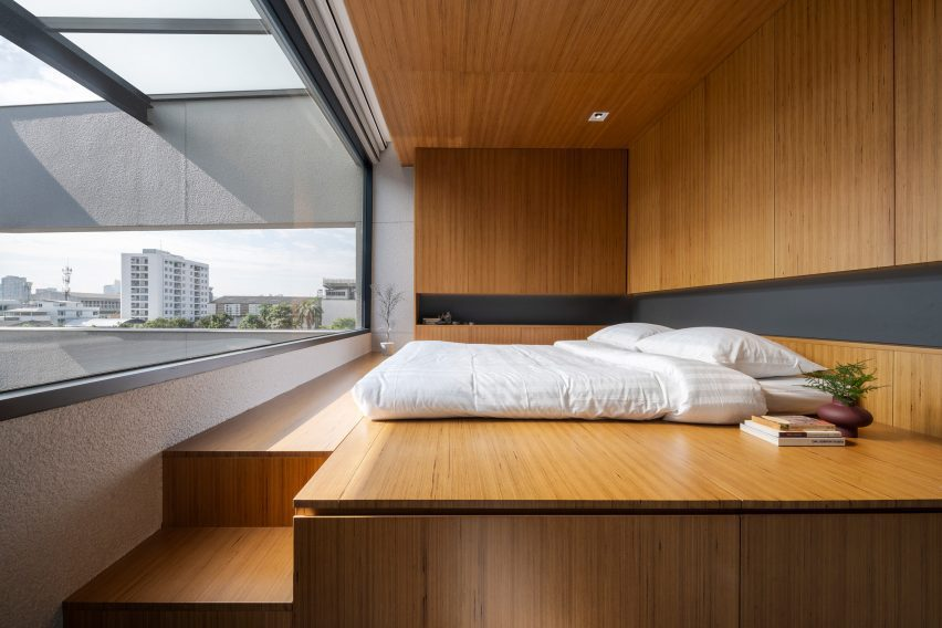 Bedroom of 55 Sathorn house by Kuanchanok Pakavaleetorn Architects