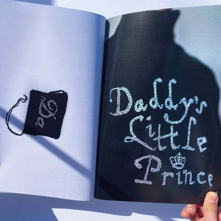 """A book of embroidered work. This page says """"Daddy's little Prince"""""""