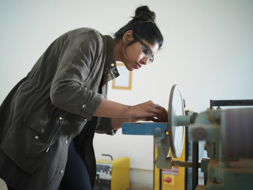 A Pearl Academy design student operating a machine