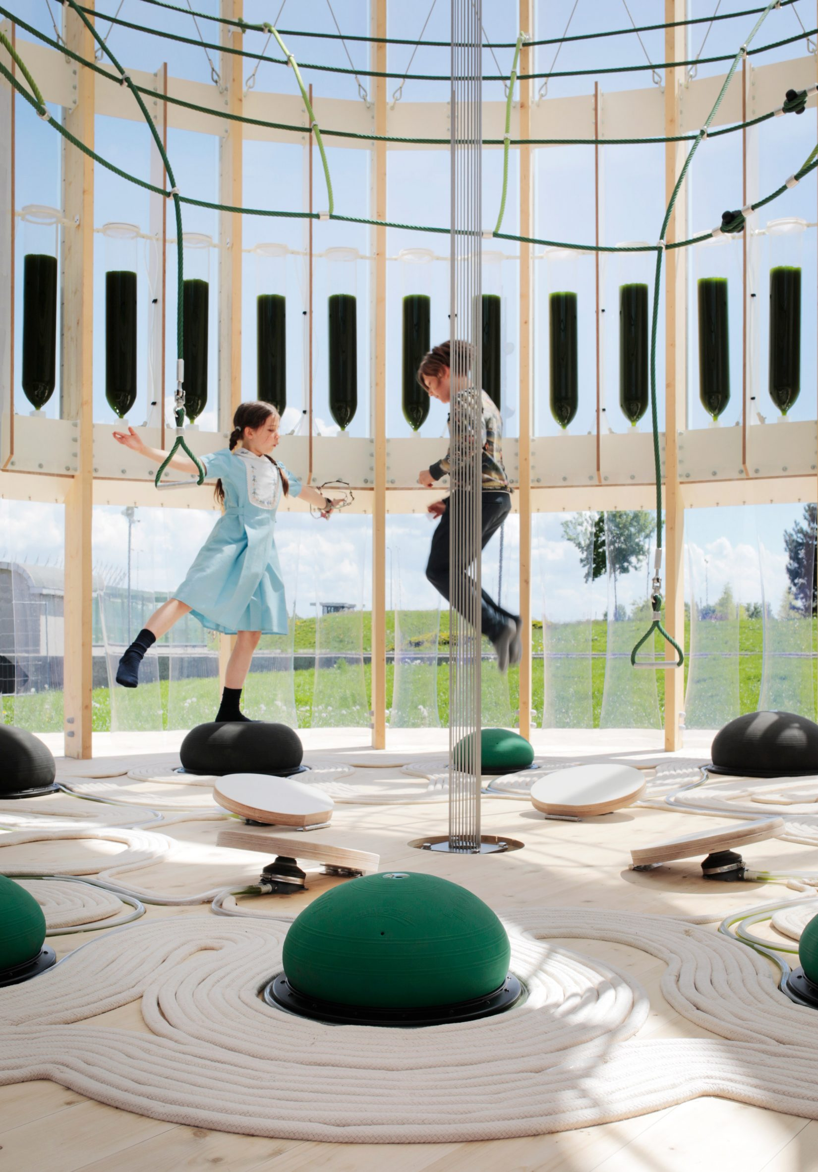 Children bounce on spheres inside the AirBubble playground
