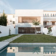 Large wooden shutters filter light and air into Mallorcan home by Company Studio