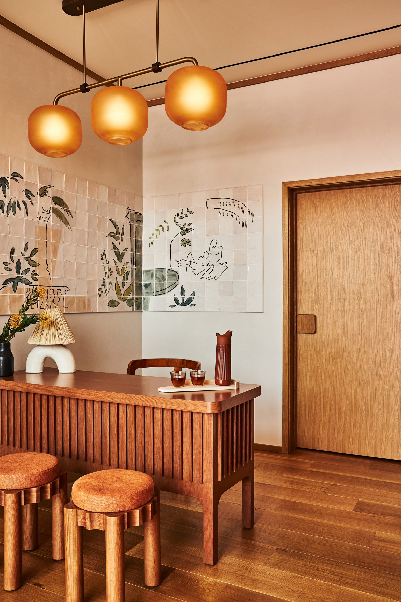 Reception area with tile mural at Alsace LA hotel