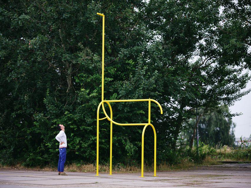 Boscardin stands next to a life-size giraffe sculpture
