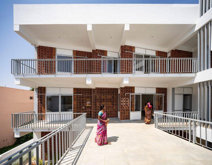 Sharana daycare by Anupama Kundoo has a brick and white painted exterior