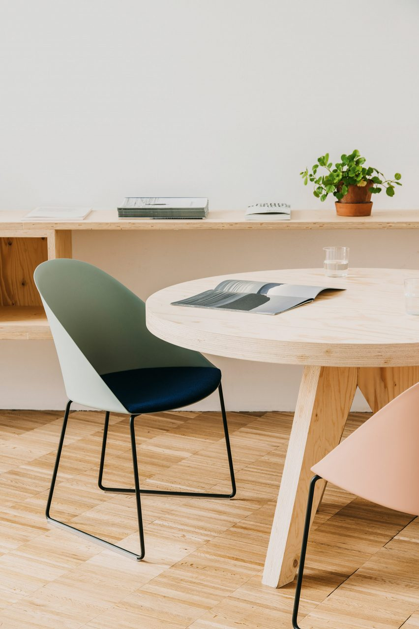 A photograph of a green and navy chair at a table