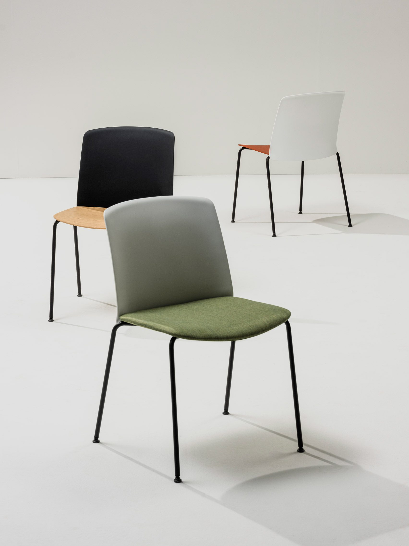 A photograph of different chairs in various colours