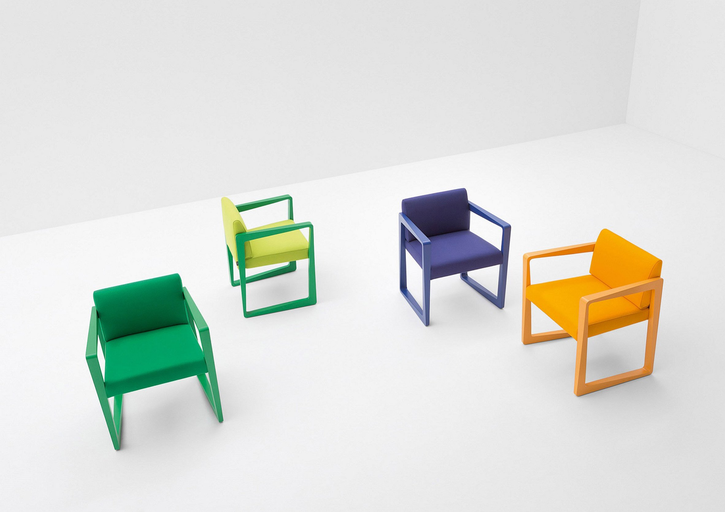 Askew chair in green, yellow, blue and orange colours