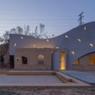 Atelier Xi transforms abandoned house into library with curved concrete walls