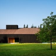Caserío Azkarraga is a restaurant and residence wrapped in blackened timber