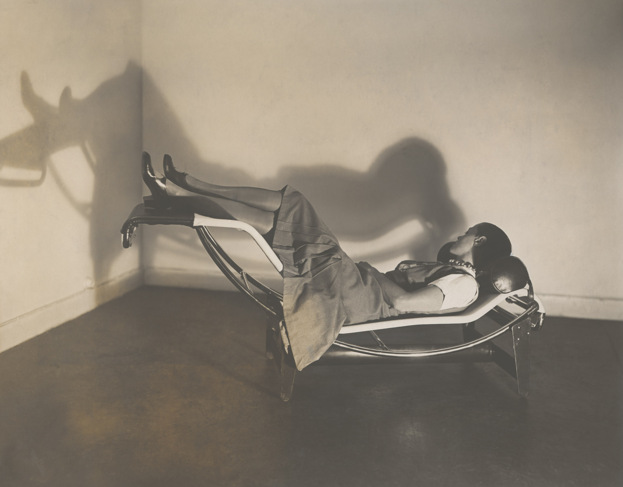 Charlotte Perrian reclining on a chaise longue